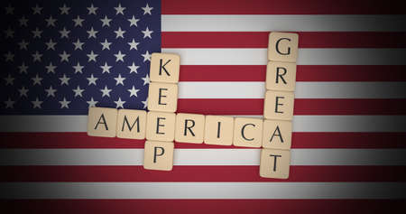 USA Politics Concept: Letter Tiles Keep America Great On US Flag, 3d illustration Reklamní fotografie
