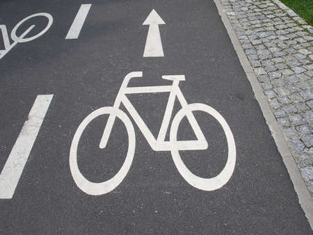 Traffic Sign: Bicycle Symbol On A Wet Asphalt Bikeway In Berlin, Germany