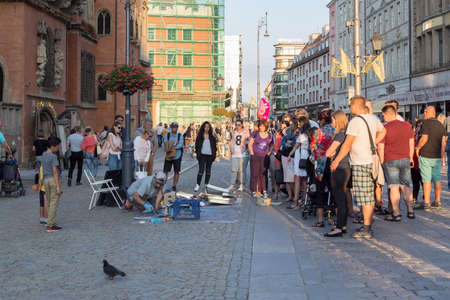 WROCLAW, POLAND - AUGUST 14, 2017: Street Painter Painting With Spray At Rynek Market Square In Wroclaw Editorial