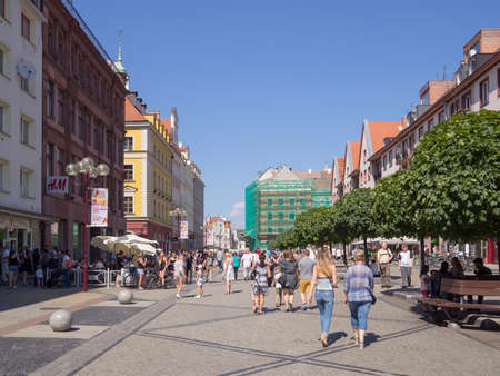 WROCLAW, POLAND - AUGUST 14, 2017: Tourists In The Inner City In Wroclaw, Poland In Summer