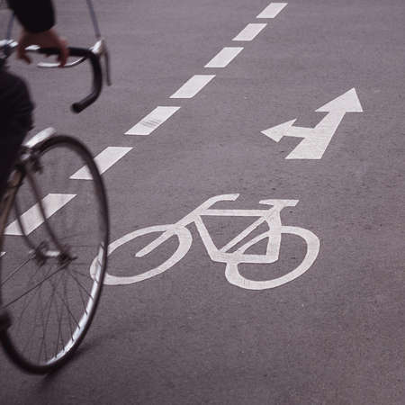 Blurry Bicycle On A Cycle Path With A Bicycle Symbol And Arrows