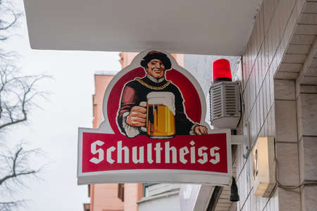 BERLIN, GERMANY - FEBRUARY 5, 2020: Advertisement: Old Logo of German Schultheiss Beer Outside At A Wall In Berlin, Germany
