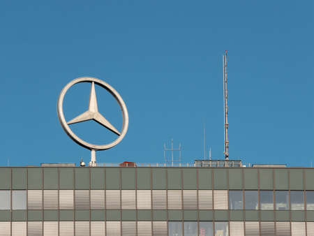 BERLIN, GERMANY - FEBRUARY 10, 2020: Mercedes Logo On A Roof Against A Blue Sky In Berlin, Germany