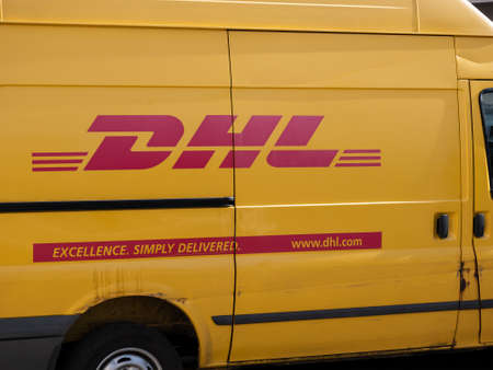 BERLIN, GERMANY - JUNE 4, 2020: Small Truck of Package Delivery Company DHL With English Slogan In Berlin, Germany