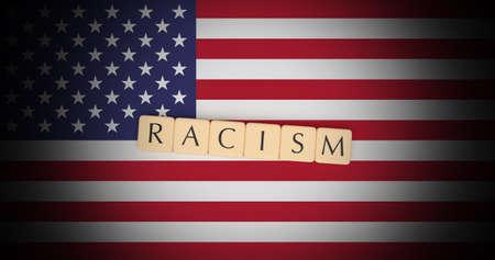 United States News Concept: Letter Tiles Racism On US Flag, 3d illustration