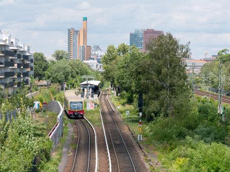 BERLIN, GERMANY - JUNE 6, 2020: S-Bahn Train In Front of Potsdamer Platz Skyscrapers And Dome In Berlin, Germany