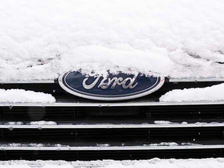 BERLIN, GERMANY - JANUARY 30, 2021: Close-up of A Snow-capped Ford Logo On A Car In Berlin, Germany Редакционное