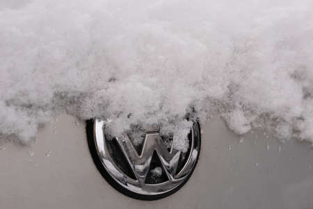 BERLIN, GERMANY - JANUARY 30, 2021: Close-up of A Snow-capped VW Logo On A Car In Berlin, Germany Редакционное