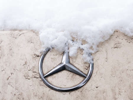 BERLIN, GERMANY - JANUARY 30, 2021: Close-up of A Snow-capped Mercedes Star Logo On A Car In Berlin, Germany Редакционное