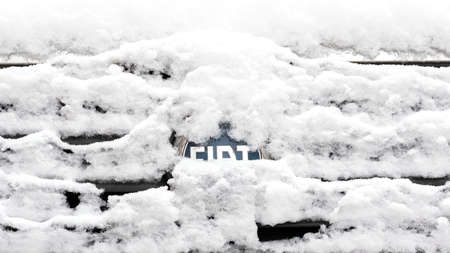 BERLIN, GERMANY - JANUARY 30, 2021: Close-up of A Snow-capped Fiat Logo On A Car In Berlin, Germany