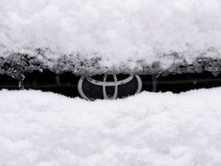 BERLIN, GERMANY - JANUARY 30, 2021: Close-up of A Snow-capped Toyota Logo On A Car In Berlin, Germany