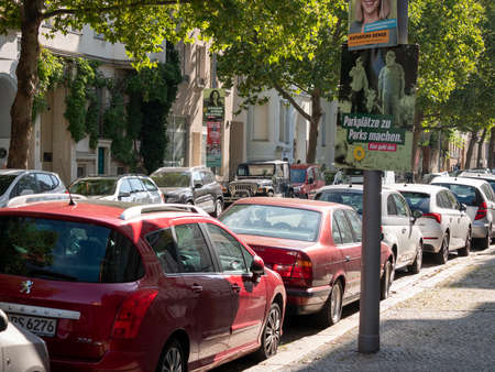 Campaign Posters of The Greens At A Street With Many Parking Cars In Berlin