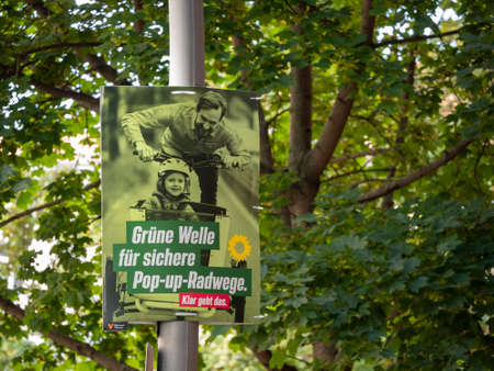 Campaign Poster of The Greens In Front of Trees In Berlin Редакционное