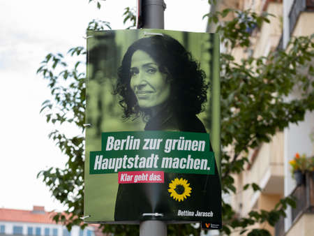 Campaign Poster of Bettina Jarasch And The Berlin Greens In Front of Trees And Houses In Berlin
