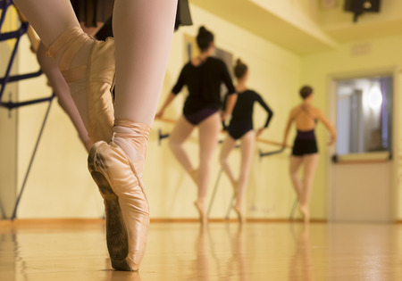 On the tips; the dancers try positions for their show focused on the work that still awaits