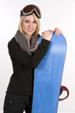 Beautiful Blonde Woman poses with her Snowboard photo