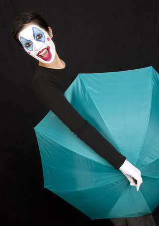 clowning: Beautiful Clown plays around with an umbrella