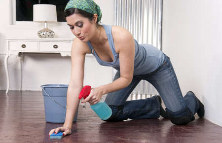 Housekeeper on her knees  Stock Photo