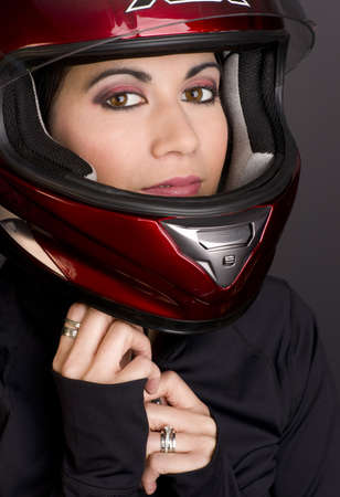 Full Face Helmet protects a beautiful brunette woman Stock Photo - 14669516