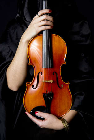 A robed figure holds a beautiful Violin