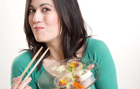 Beautiful woman Smilin with Sushi Stock Photo