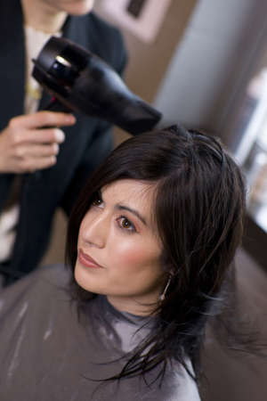 A haircut and blow dry at the salon photo