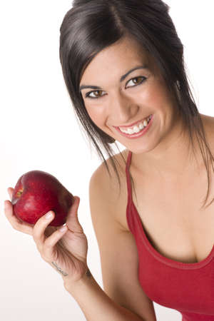 Beautiful Brunette with Apple Stock Photo - 14593314