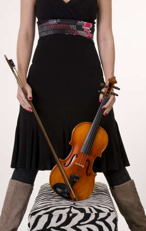 A musician hols her Bow and Violin Stock Photo - 14517116