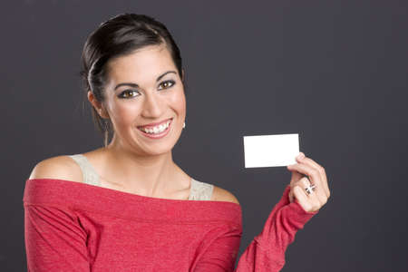 A Pretty Woman holds a business card photo