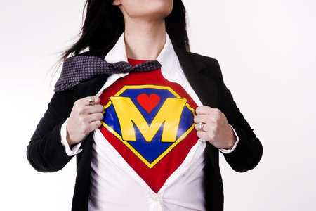Woman wears a superhero style t-shirt under her business suit Stock Photo - 14517432