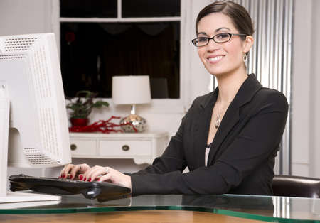 data entry: A pretty receptionist smiles at the viewer