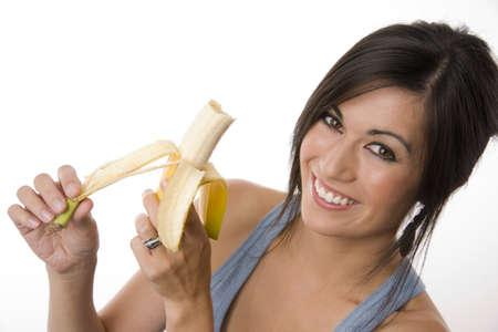 Beautiful Brunette holds a Banana photo