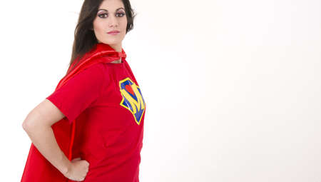 crime fighter: A Woman wears a superhero style t-shirt and cape