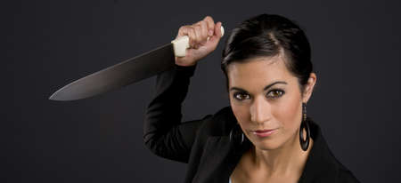 stab: Pretty Woman getting ready to stab you  Stock Photo