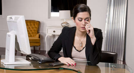 A pretty receptionist endures pain Stock Photo - 14593325