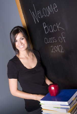 accepts: Pretty Teacher Accepts an Apple Stock Photo