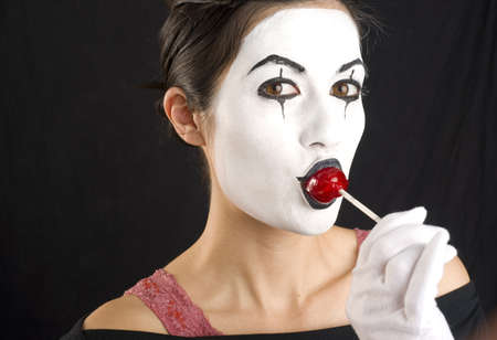 sucker: A female Mime enjoys a sucker