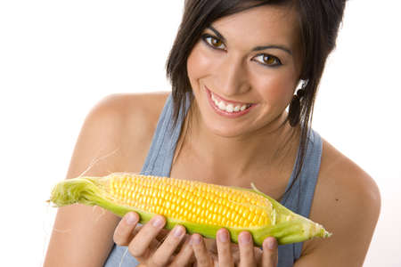 A Beautiful Brunette holds a corn stalk photo