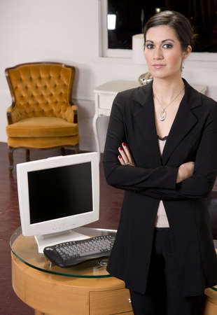 A Business Woman standing in front of her desk Stock Photo - 14593345