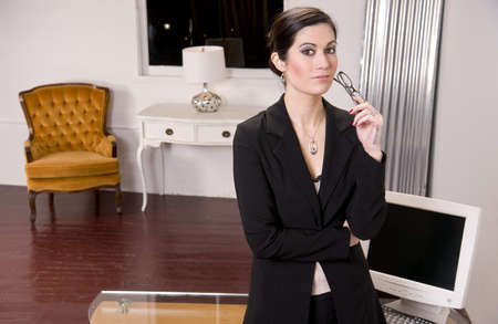 A Business Woman standing in front of her desk Stock Photo - 14593337