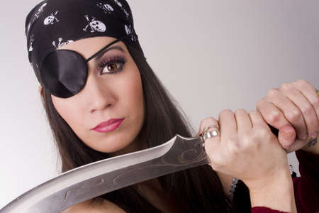 specific clothing: A beautiful pirate shows you her blade Stock Photo
