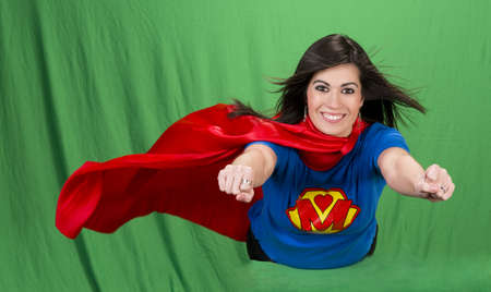 woman flying: Beautiful woman plays super mom flying on green screen
