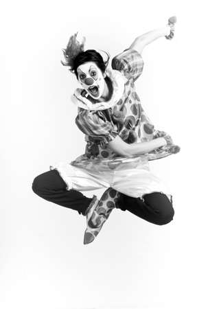 clowning: Woman jumps into the air a clown performer
