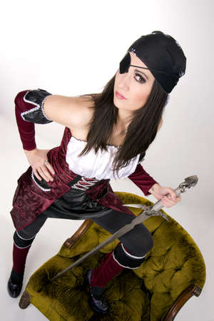 A pirate woman with an eye patch shows her sword photo