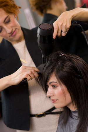 A haircut and blow dry at the salon Stock Photo - 14669298