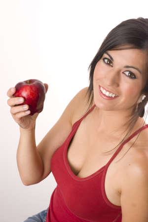 Beautiful Brunette with Apple Stock Photo - 14669294