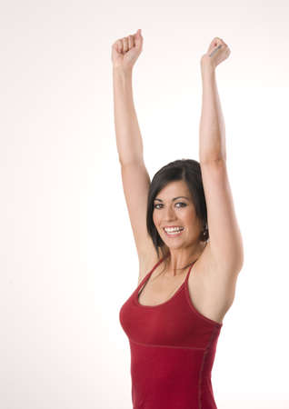 Beautiful Brunette arms raised Stock Photo - 14599837