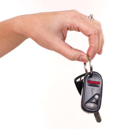 A womans hand holds car keys