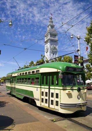 san francisco: San Francisco Trolley Car moves through the street