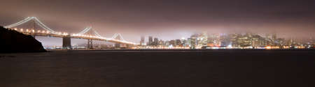 Bay Bridge and San Francisco in the Fog at night photo